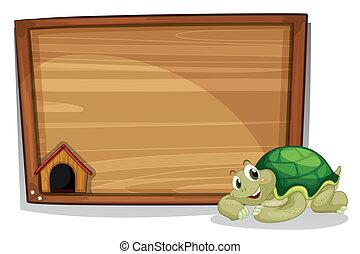 A turtle beside the empty wooden board