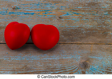 A two red heart on the wooden background with copy space