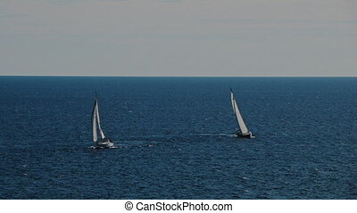 A two sailboats on the horizon in the beautiful Adriatic sea