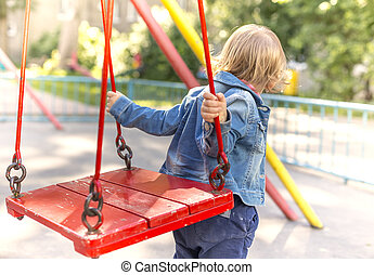 girl jumps or jumps on a swing