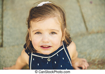 two years old child girl on urban street - A two years old...