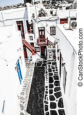 A typical narrow alley in the town of Mykonos, Greece ( HDR...