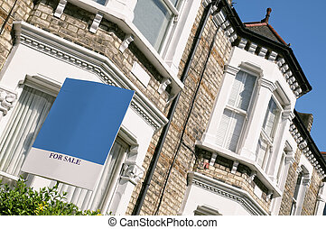 """A typical red-brick townhouse with """" FOR SALE"""" sign and copy space at West-London."""