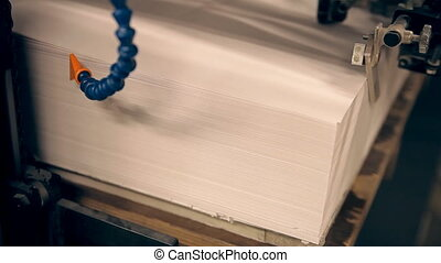 A typography prints newspapers - A machine is giving the...