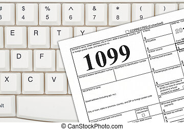 A US Federal tax 1099 income tax form on a keyboard