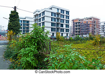 vacant lot between two houses - a vacant lot between two...
