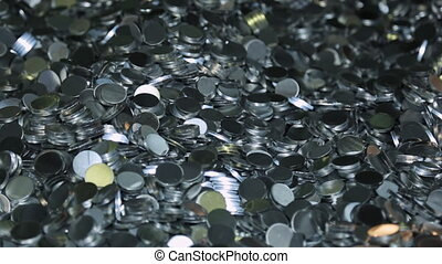 A variety of aluminum round bars workpiece in a heap shiny...