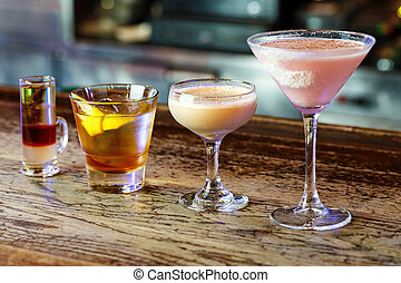 a variety of cocktails in a nightclub