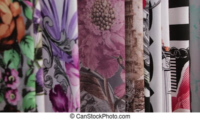 A variety of colorful fabric samples on display. Automated...