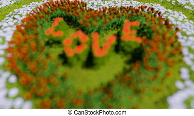 A variety of flowers in the shape of a heart on a green field, as a symbol of Valentine`s Day and love