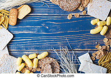 A variety of gluten-free foods on a blue wooden background. Top view. Gluten free food with copy space.