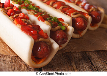 A variety of hot dogs on a table macro. Horizontal