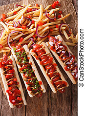 A variety of hot dogs on a table macro. vertical top view