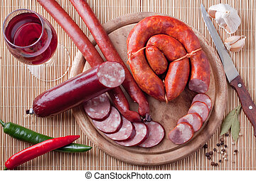 A variety of processed cold meat products, on a wooden...