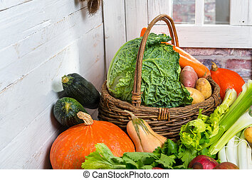 variety of raw vegetables on the wooden basket
