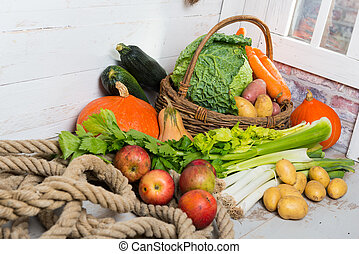 variety of raw vegetables on  the wooden table