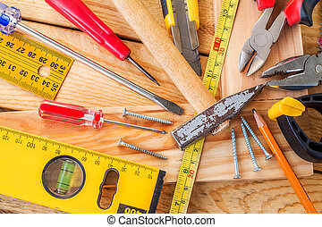 A variety of tools on wood