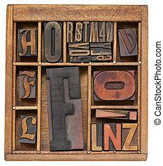 variety of vintage letterpress printing blocks