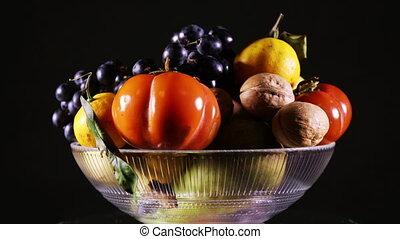 A vase of fresh fruit rotating - A vase with fresh fruit...