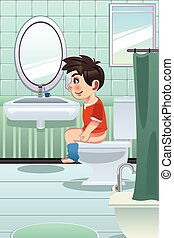Boy Sitting on the Toilet in the Bathroom