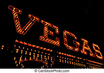 Vegas illuminated sign - a Vegas illuminated sign at night