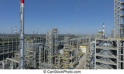 A vertical inspection of some unit of an oil refinery - A ...