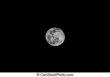 A very crisp structured and bright full moon in a black nightv sky