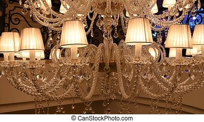 A very expensive chandelier in a chic restaurant or concert hall. Concept of luxury life.