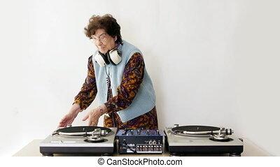 a very funky elderly granny dj! go lady!