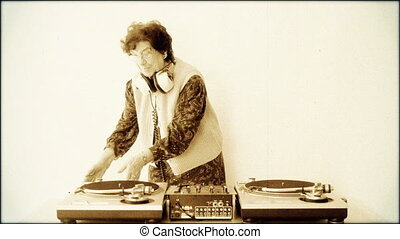 a very funky elderly granny dj! go lady! with aged film...