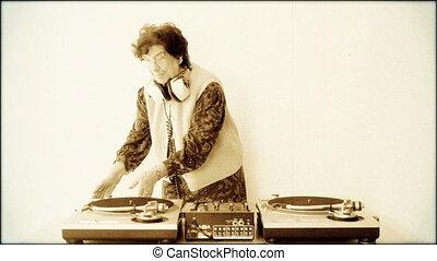 a very funky elderly granny dj! go lady! with aged film...