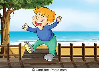 A very happy boy at the bridge