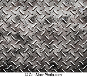 a very large sheet of rough black diamond plate with pits and marks