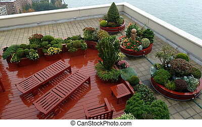 a very nice rooftop deck on a rainy day