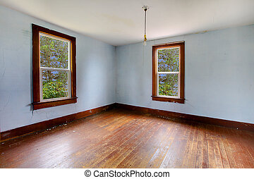 A very old empty room with bright blue walls - Build in 1907...