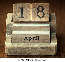 A very old wooden vintage calendar showing the date 18th...