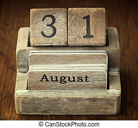 A very old wooden vintage calendar showing the date 31st August