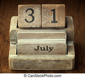 A very old wooden vintage calendar showing the date 31st July on