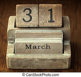 A very old wooden vintage calendar showing the date 31st March