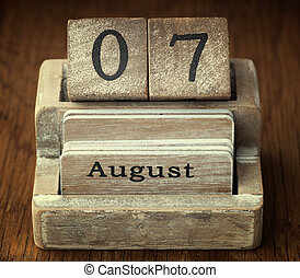 A very old wooden vintage calendar showing the date 7th...