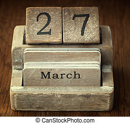 A very old wooden vintage calendar showing the date 27th...