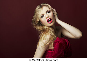 sexy blond girl on red background