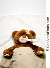 Sick Teddy Bear - A very Sick Teddy Bear laying in his bed.