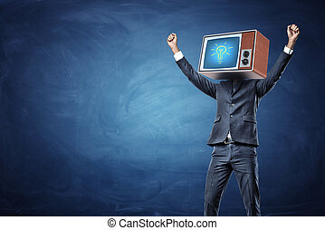 A victorious businessman with arms raised up and a retro TV showing a glowing bulb on his head.
