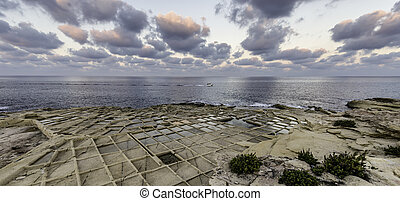 A view across the salt pans at Bahar ic-Chaghaq on the northern coast of Malta