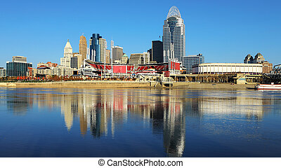 View Cincinnati skyline with Ohio River reflections