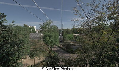 A view from a moving cabin of a cableway - A view from a...