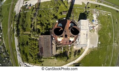 A view from above of the smokestack of a metallurgical...