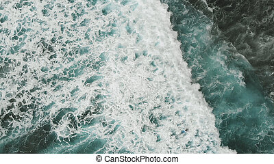 A view from the drone to the stunning turquoise ocean and the big waves with sea foam. Atlantic, Spain