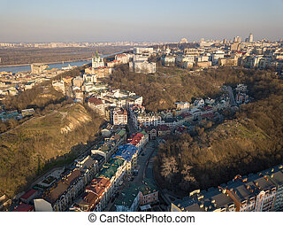 A view from the height of Vozdvizhenka with new residential houses, Bald mountain and St. Andrew's Church in the Kyiv city